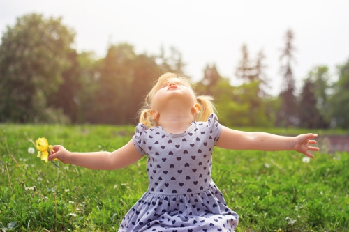 Little girl with her arms open, life concept