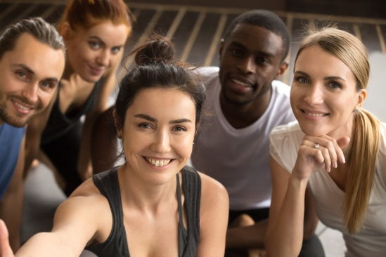 Young Smiling Sporty Multiracial Friends Taking Group Selfie Pho