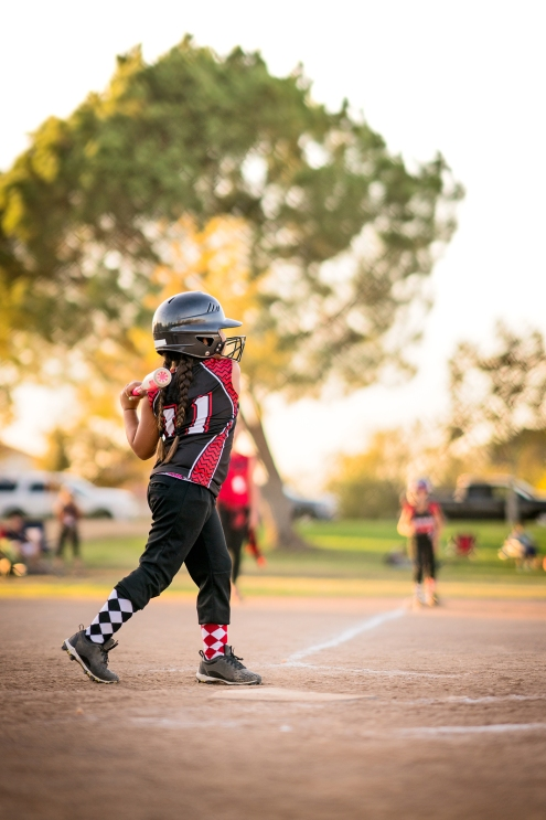 Girl playing softball or baseball